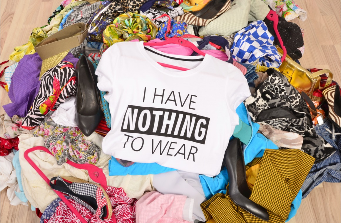 big pile of clothes thrown on the ground