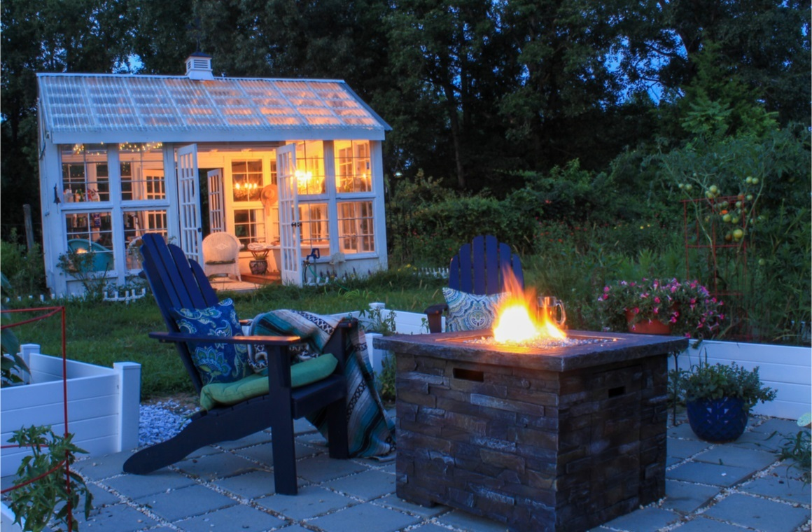 beautiful garden scene at dusk with firepit