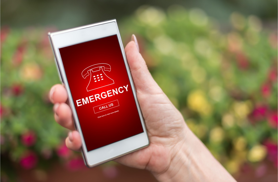 hand holding a smartphone with emergency concept