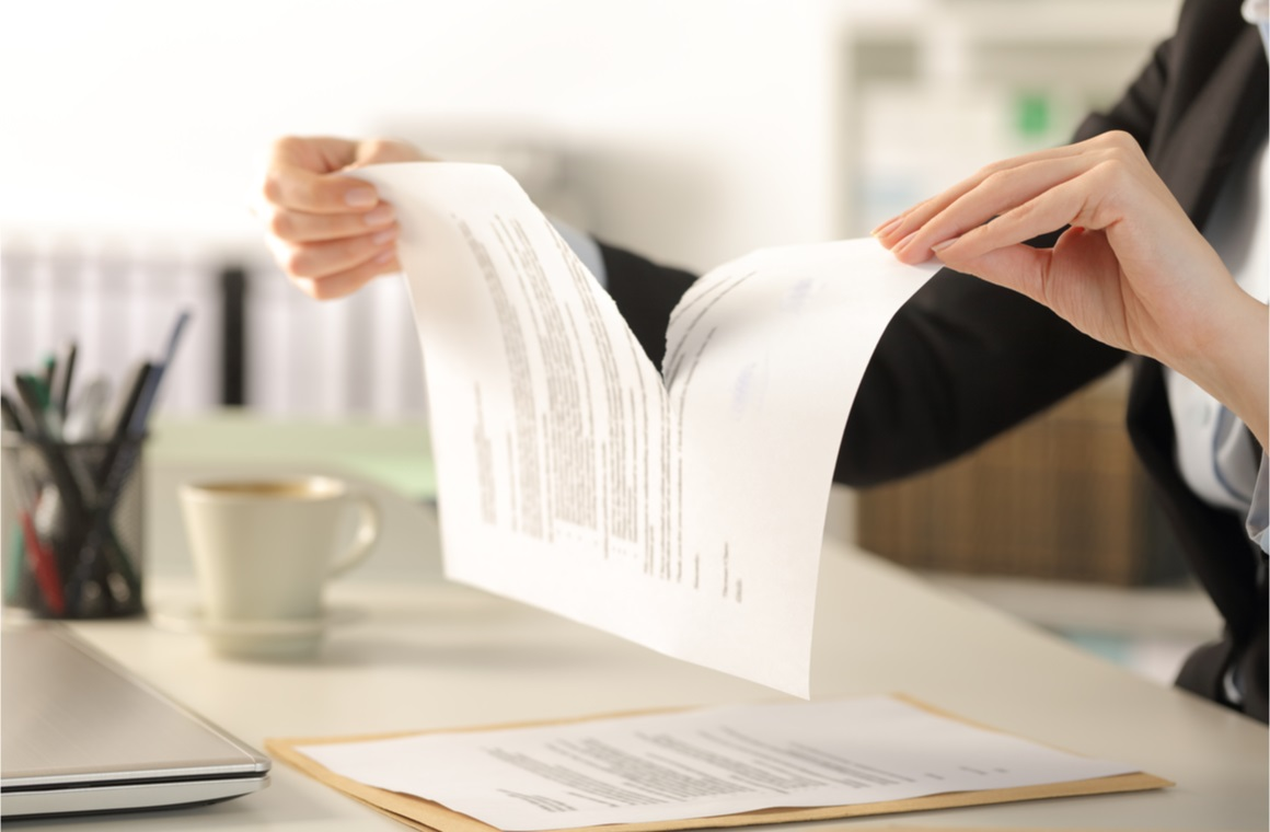 woman hands breaking contract document