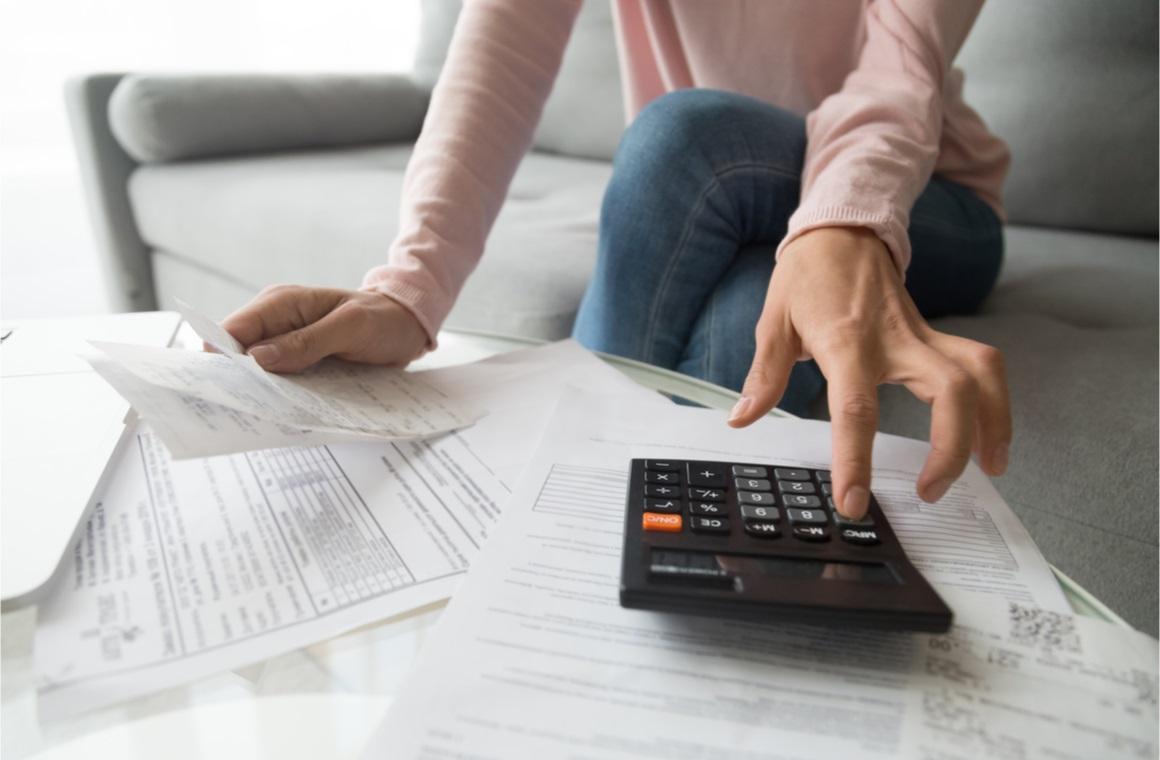 woman renter holding paper bills