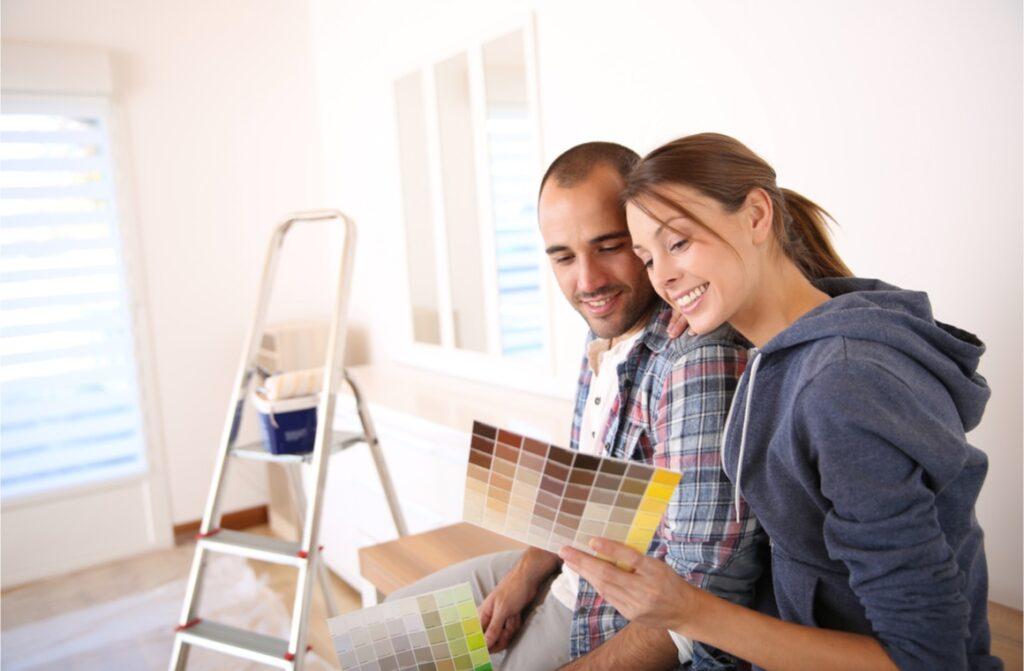 Happy couple choosing paint colors
