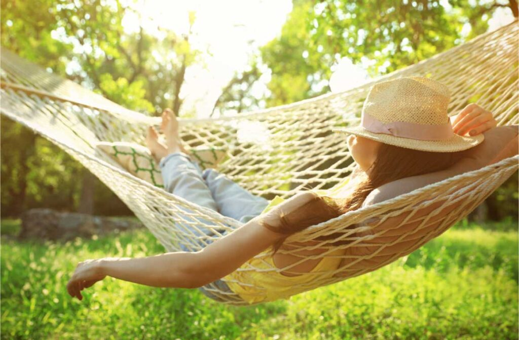Young woman resting comfortable in hammock