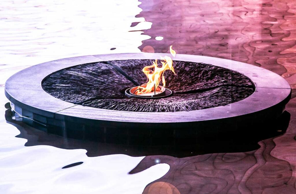 Flame burning in water feature