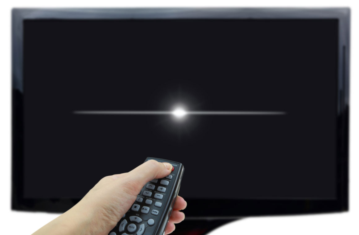 hand remote control in front of a black tv