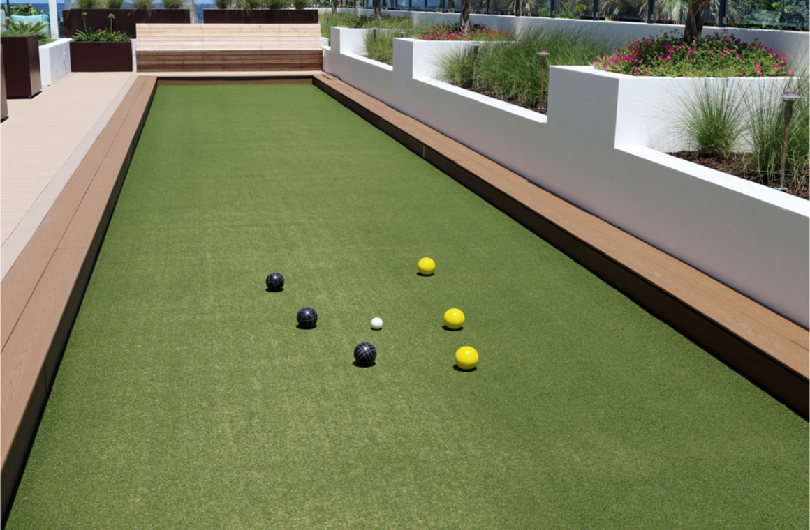 inviting bocce ball court with artificial turf